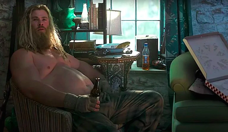 shirtless thor with a beer belly